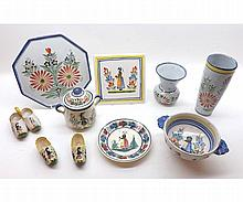 A collection of Quimper Wares, all typically decorated with figures etc, comprises an octagonal Stand, Teapot Stand, Saucer, two-handled circular Bowl, two-handled Covered Pot, two Vases and decorative Clogs