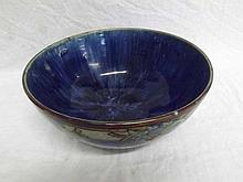 "A Royal Doulton Circular Bowl of tapering form, decorated in colours with fruit design on a dark blue ground, impressed marks by Ethel Beard, 11"" diameter"