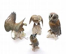 """A mixed lot of 20th Century Bird of Prey models to include Spode model of a Little Owl raised on plinth base together with Continental models of a Fish Eagle, Long Eared Owl and Tawny Owl raised on naturalistic bases, largest piece 10"""" high (4)"""
