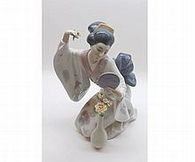 """A mixed lot comprising a Lladro model of a Geisha Girl numbered 6748 to base and further boxed Lladro model of a baby seal, largest piece 9"""" high (2)"""