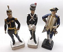 """A mixed lot comprising Royal Worcester Papal Series """"Officer of the Palatine Guard"""", """"Papal Gendarme"""" and further Royal Worcester figure """"Admiral"""" number 2661, largest 12"""" high (3)"""