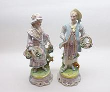 "A pair of late 19th Century Continental Figures of lady and gent in period dress, raised on circular plinth bases, largest 13 ½"" high"