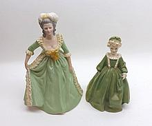 """A Mixed Lot comprising: a Royal Worcester Figurine, Grandmother's Dress; together with Franklin Porcelain Figurine, Mary Antoinette, largest piece 8 ½"""" high (2)"""