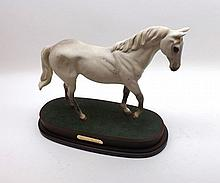 "Royal Doulton model ""Desert Orchid"" on a plush lined stand, 7 ½"" high"