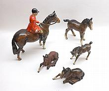 Beswick model of a Shire foal (large), 951, brown finish, two further models of lying foals number 915 in brown and brown matt finishes, further model of a foal (medium, head down) 1085, brown finish (tail repaired), and one other model of a
