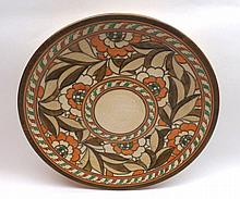"A Crown Ducal Charlotte Rhead Charger, decorated with abstract floral design, Rhead signature to reverse and Numbered 4491, 12 ½"" diameter"