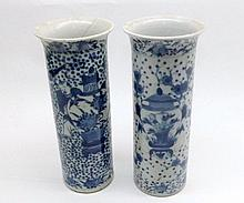 """Pair of Chinese Cylinder Vases, with slightly everted rims, decorated in the Kangzsai manner with Jardinières and figures, 4 character marks (both with extensive hairline cracks and repairs etc), 8 ¼"""" high"""