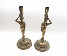 """Unusual pair of 19th Century Brass Candlesticks modelled as nude male figures raised on circular plinth bases, 12"""" high"""