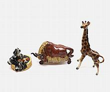 """A Mixed Lot comprising: a Goebel Model of a basket of puppies, a further German Model giraffe and Studio Pottery Model yak, largest piece 9"""" high (3)"""