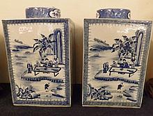 """A good pair of 20th Century Chinese Large Tea Storage Caddies of square form, each with circular covers, painted in underglaze blue with panels of Chinese river scenes with figures, interspersed with panels of floral sprays and sprigs etc, 15"""" high"""