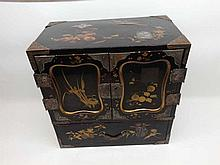 """A 20th Century Oriental Lacquered Table Top Cabinet and also inlaid in the Shibayama manner, and with silver plated mounted corners and further mounts throughout, two doors enclosing fitted drawers over a full width drawer, 24 ½"""" wide"""