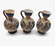 "Three Royal Doulton Slaters Jugs, typically tube-lined and decorated in colours with foliage (two have spout and rim chips), all 6"" high"