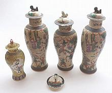 Mixed lot of early 20th Century Oriental crackle glazed lidded vases of baluster form, decorated with various scenes of warriors together with a further 20th Century Chinese yellow glazed lidded baluster vase and an additional lid, largest piece