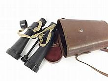 """A cased pair of Government issue Binoculars, Barr & Stroud, 7X, CF 41, Glasgow & London, of typical black finished construction with textured grips and large broad arrow detail fitted in a stitched leather case with carry strap, length 10"""""""