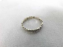 "A high grade precious metal all small Brilliant Cut Diamond Surround Eternity Ring, stamped ""18ct"""