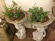 """Pair of contemporary composition garden urns, with spreading bowls raised on cherub formed supports, 33"""" wide"""