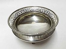 An Edward VII Silver Bowl with floral decorated pierced rim and tapering body, raised on four short feet, hallmarked for London 1902, Maker Clement Charles Pilling, weight approx 340 gm