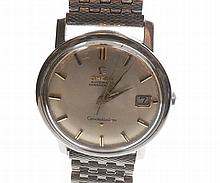 A third quarter of the 20th Century Stainless Steel Sweep Centre Seconds Calendar Wristwatch, Omega, Cal 561,239322970, the 24 jewel automatic movement with lever escapement to a signed silvered circular dial with gilt and black applied baton markers