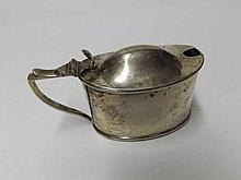 An Edward VII Oval Silver Mustard with hinged lid, looped handle and blue glass liner, hallmarked for Birmingham 1909, weight 55 gm