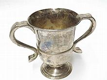 A George III Cup with double scrolled handles, raised on a spreading circular base, hallmarked Newcastle 1770, Maker John Langlands, weight 330 gm