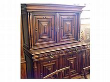 """A 19th Century Flemish Walnut Two-Piece Side Cabinet, top section with moulded cornice, pillared side supports and two panelled doors, base with two short drawers, two panelled doors, pillared supports and shaped plinth, 55"""" wide"""