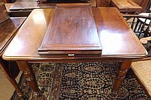 """Victorian Mahogany extending Dining Table with extra leaf raised on turned legs and casters, 41"""" wide unextended"""