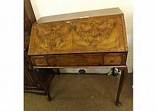 """An 18th Century and later Walnut Bureau Cabinet, the fall front opening to reveal an interior with pigeonholes and small drawers and a central well with sliding lid, the body with two short drawers, raised on cabriole legs, 36"""" wide"""