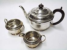 A George V Silver Three Piece Tea Service comprising teapot, double-handled sugar basin and cream jug, hallmarked Birmingham 1935, maker William Aitken, weight approx 600 gm