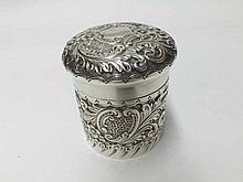 An Edward VII Silver floral decorated Dressing Table Canister of circular form with pull-off lid, hallmarked for Birmingham 1902, weight approx 100 gm