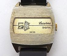 A third quarter of the 20th Century Gold Plated Digital type Wristwatch, Lucerne, the Swiss movement (unsigned) to a gilt rectangular movement with hour and minute apertures, in a brushed rectangular case with fitted black leather strap, width 1