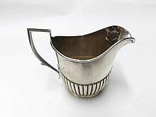 An Edward VII Silver Milk Jug of tapering form with ribbed decoration to body, hallmarked Birmingham 1909, Maker's Mark JR, weight 125 gm