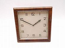 Third quarter of 20th Century timber framed easel back timepiece, with plain and polished moulded square surround, to a squared and silvered dial with applied Arabic numerals, outside minute track and further silvered and pierced hands, to an 8-day