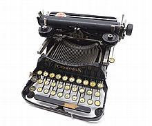 An early 20th Century Corona Portable Typewriter