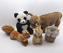 A collection of assorted modern Steiff animals to include Panda, Cow, Chipmunk,