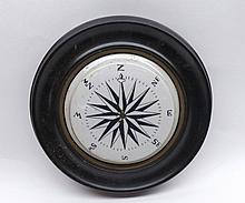 Unusual ceramic lid decorated in the form of a compass in circular wooden frame,