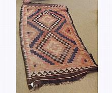 Kilim Rummer, geometric designs on a mainly puce field within brown borders, 5'