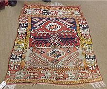 Kilim Rug, central panel of interlinked lozenges within geometric border, mainly