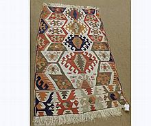 Kilim Runner decorated with an all over lozenge/geometric design, mainly beige f