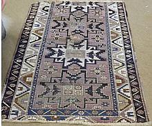 Caucasian Rug, triple gull border, central panel of geometric designs, mainly ma