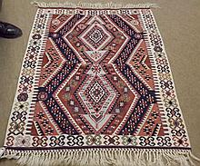 Kilim Rug, centre decorated with interlinked lozenges and geometric designs with