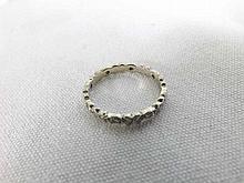 A high grade precious metal all small Brilliant Cut Diamond Surround Eternity Ri