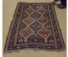 Caucasian Carpet, central panel of interlinked lozenges, mainly blue field, 5' x