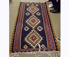 Kilim Rug, central panel of three lozenges on a predominantly blue, red and ochr
