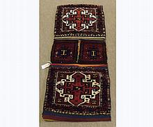 Caucasian Saddle Bag type carpet, decorated with four panels of geometric design