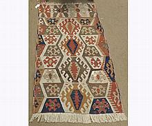 Kilim Rug decorated with multi-panelled geometric design with lozenges etc on a