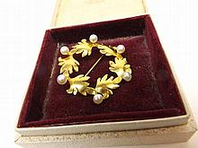 A good quality high carat yellow metal and Pearl set open work circular Brooch o