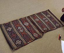 Caucasian Saddle Bag type carpet, decorated with parallel panels of geometric de
