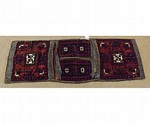 Caucasian type Saddle Bag carpet, decorated with geometric designs on a mainly r