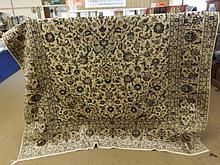 A good quality modern Keshan Carpet, multi-gull border, central panel of foliage