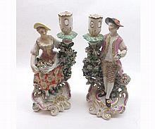 Pair of Derby Porcelain Candlestick figures of a flower seller and his fema